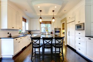 White large luxury modern kitchen wih dark floor